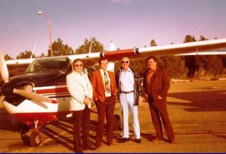 TD Barnes, Leo Crawley, pilot, and Floyd Bleak, Flagstaff, Arizona
